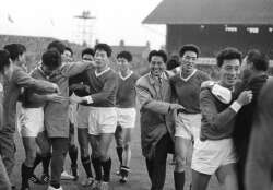 The North Korean's celebrate their historic victory against Italy